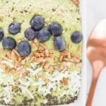 Avocado Green Smoothie Bowl - creamy green smoothie bowl topped with blueberries sunflower seeds chia seeds coconut flakes and hemp seeds