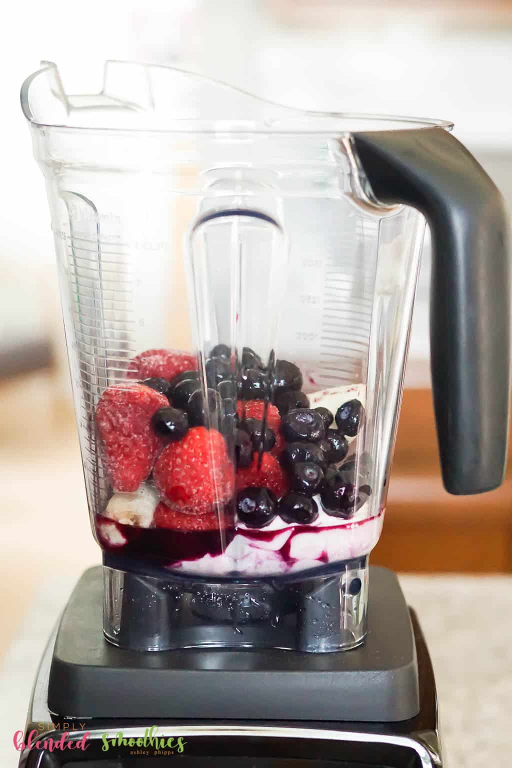 Strawberry Blueberry Smoothie Bowl ingredients in a blender
