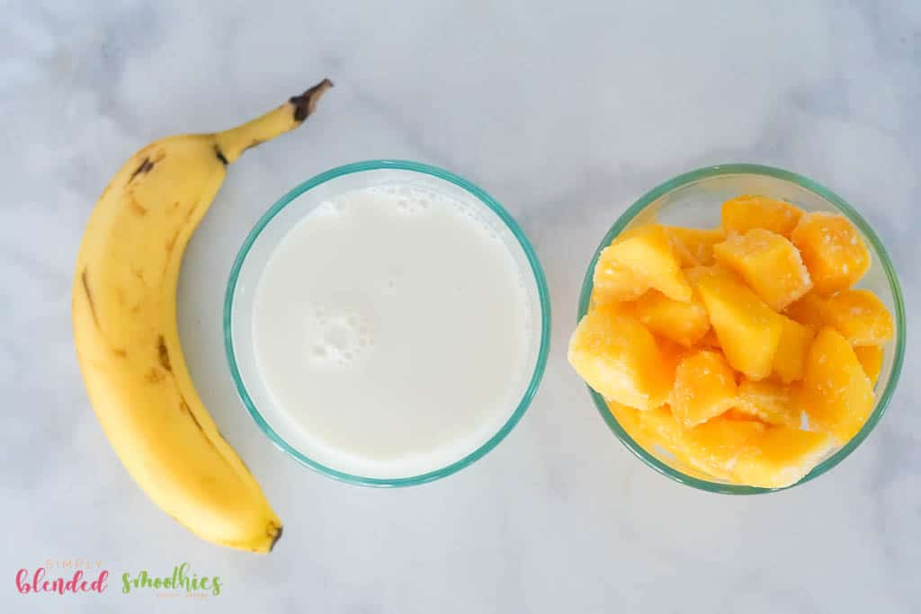 mango and banana and milk - ingredients for healthy mango smoothie