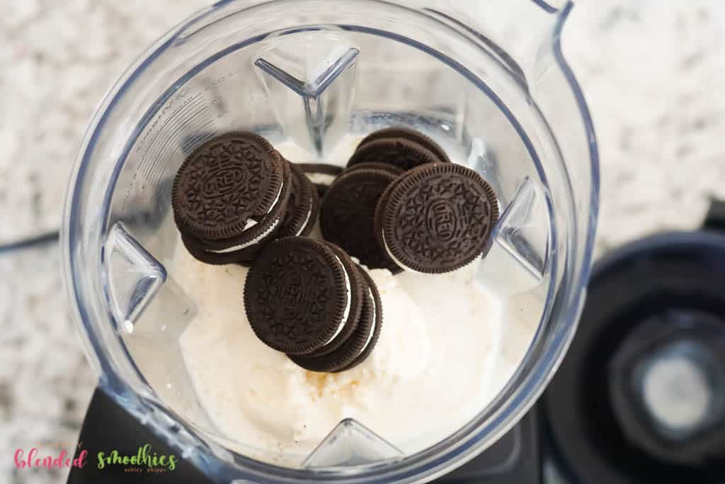 ice cream and oreos and milk in a blender