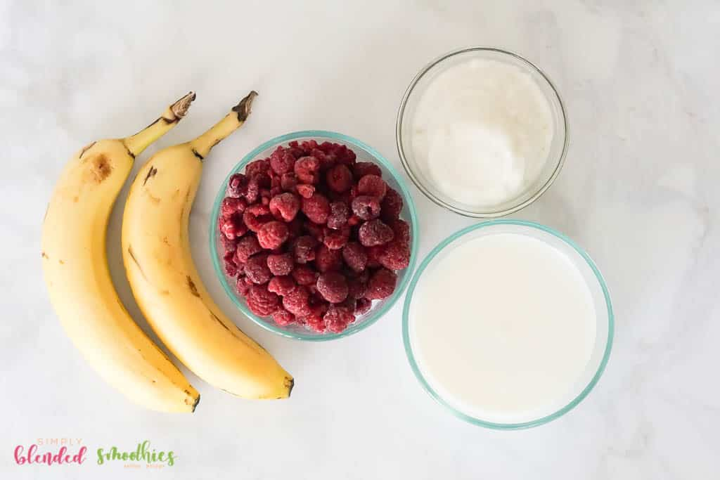 ingredients to make a raspberry banana smoothie