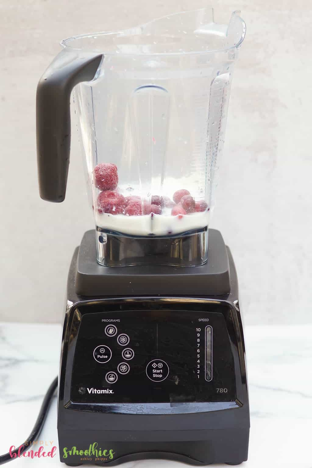 all ingredients for cranberry truffle smoothie recipe in a blender