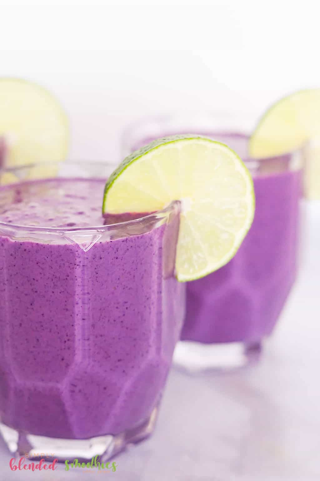 smoothie made with blueberries and banana with a splash of lime