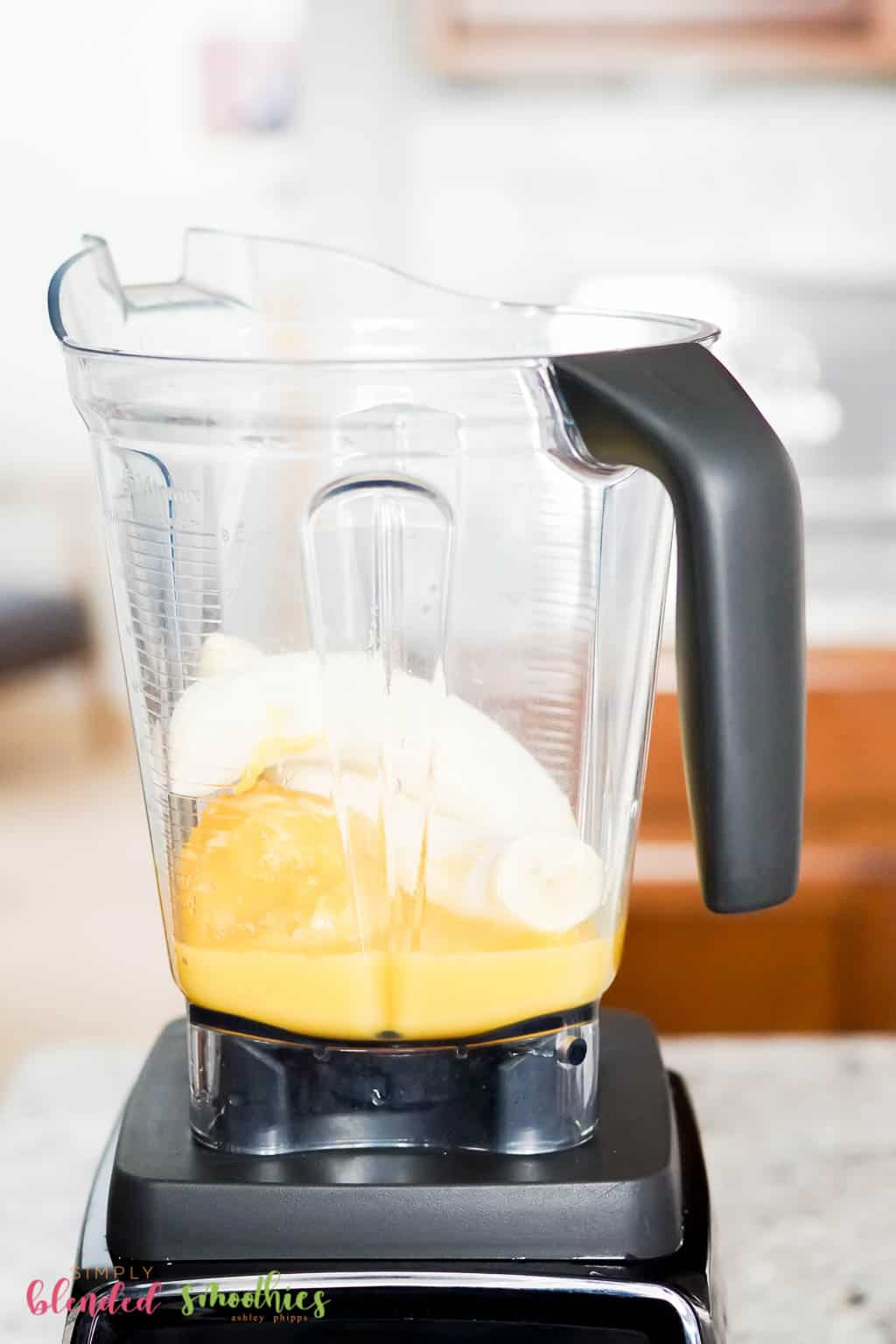 bananas and orange juice in a blender