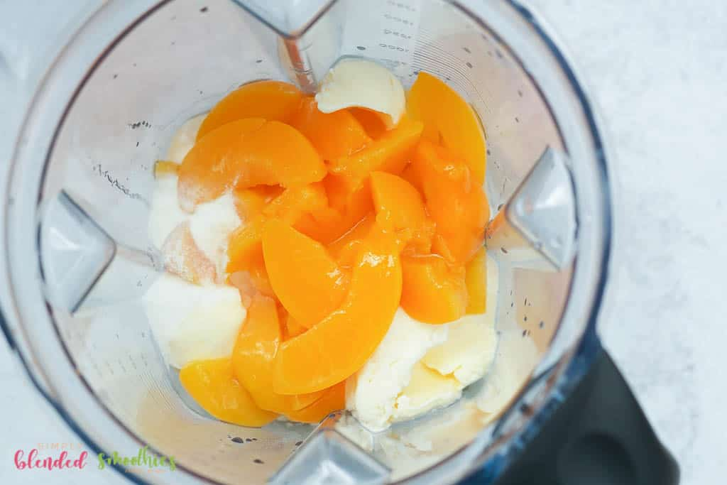 ice cream and peaches in a blender